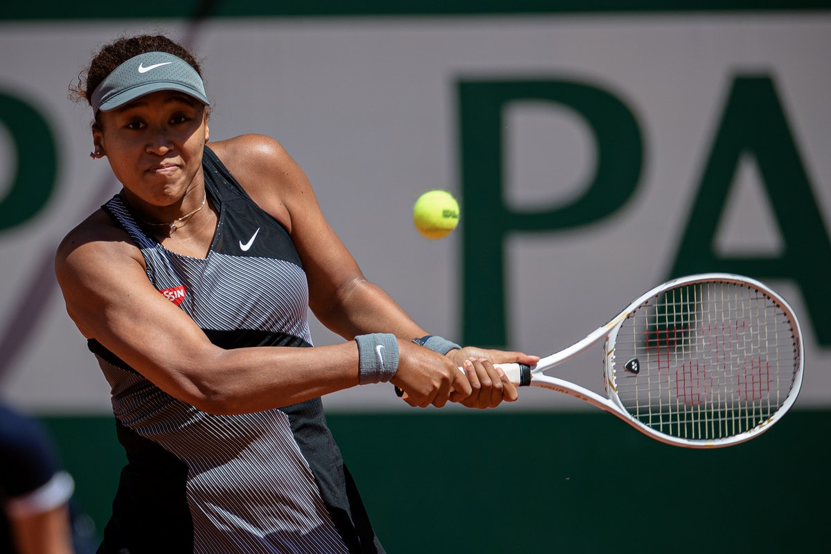 Osaka Naomi of Japan returns the ball during the women's singles first round match against Patricia Maria Tig of Romania at the French Open tennis tournament at Roland Garros in Paris, France, May 30, 2021. (Photo by Aurelien Morissard/Xinhua via Getty Images)