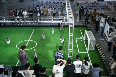 TIANJIN, CHINA - MAY 21: Robot soccer players compete in a soccer game during the 2021 RoboCup China Open, also the RoboCup Asia-Pacific (RCAP) Tianjin Invitation Tournament, which is a part of the fifth World Intelligence Congress, at Tianjin Konggang Sports Center on May 21, 2021 in Tianjin, China. (Photo by Tong Yu/China News Service via Getty Images)