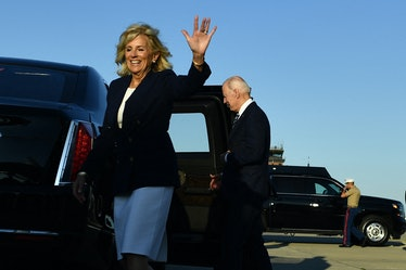 US First Lady Jill Biden (L) and US President Joe Biden gesture on arrival at Royal Air Force Milden...