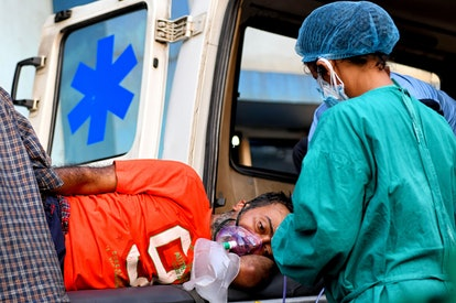 KOLKATA, INDIA - 2021/05/15: A Covid-19 patient on a stretcher is being taken for a medical check up...