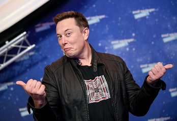 SpaceX owner and Tesla CEO Elon Musk poses as he arrives on the red carpet for the Axel Springer Awa...