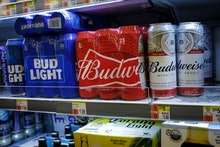 NEW YORK, NY - JULY 26: Cans of Budweiser and Bud Light sit on a shelf for sale at a convenience sto...