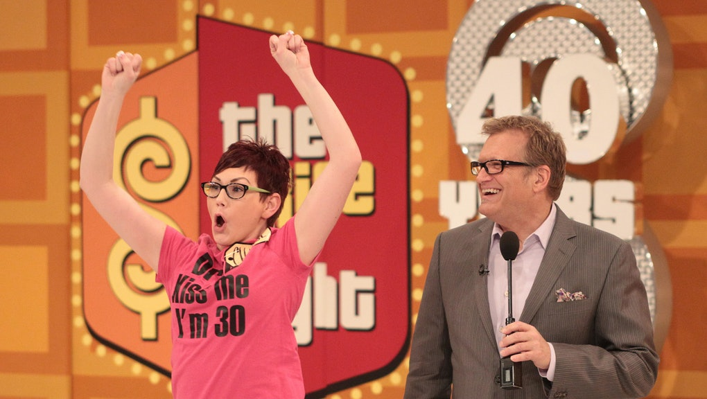 """LOS ANGELES, CA - MARCH 12: Host Drew Carey (R) and a contestant react during CBS' """"The Bold and the..."""