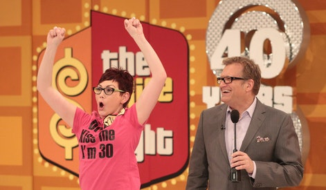 """LOS ANGELES, CA - MARCH 12: Host Drew Carey (R) and a contestant react during CBS' """"The Bold and the Beautiful"""" Showcase on """"The Price Is Right"""" television show on March 12, 2012 in Los Angeles, California.  (Photo by Frederick M. Brown/Getty Images)"""