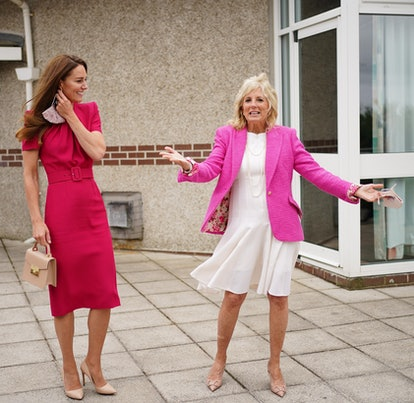 Duchess of Cambridge Kate Middleton and U.S. First Lady Dr Jill Biden wear matching rosy looks during a visit to Connor Downs Academy as part the G7 summit in Cornwall on June 11, 2021.