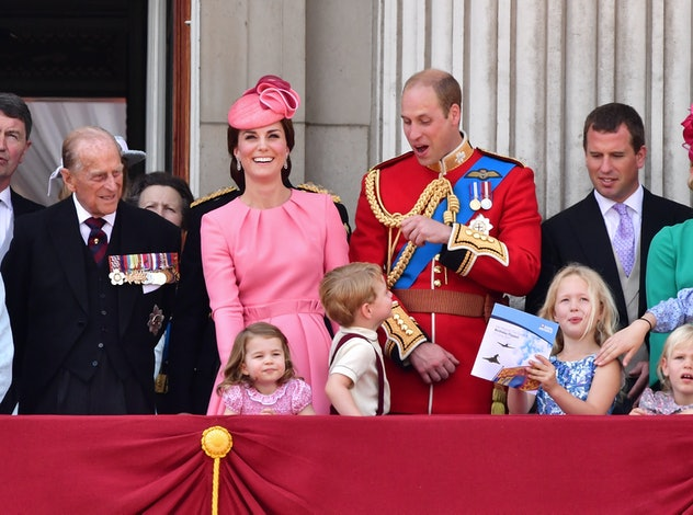 Prince Philip gets a kick out of his great-grandchildren.