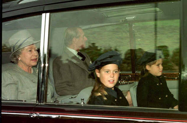 Princess Beatrice and Eugenie drive with their grandparents.