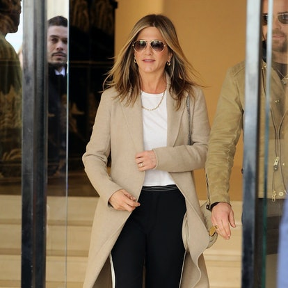 Jennifer Aniston wore a trench coat on April 12, 2017 in Paris, France.