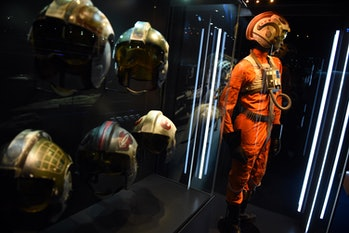 Helmets and suits of the 'Rebels' can be seen during a press tour in the exhibition 'Star Wars Ident...