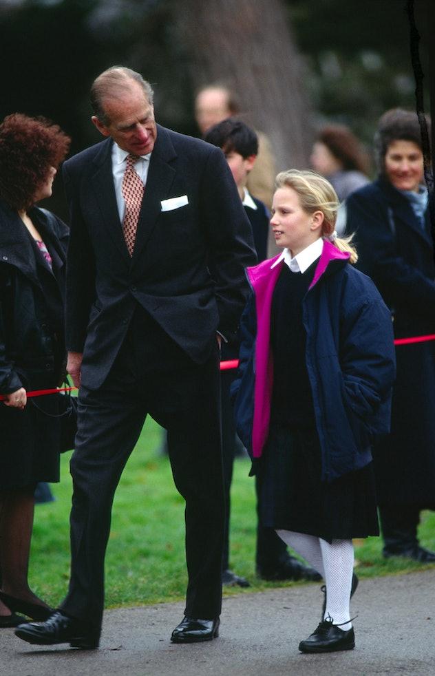 Prince Philip walks with granddaughter Zara.