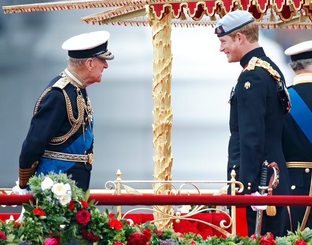 Prince Philip shares a laugh with Prince Harry.