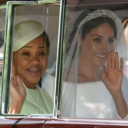 TOPSHOT - Meghan Markle (R) and her mother, Doria Ragland, arrive for her wedding ceremony to marry Britain's Prince Harry, Duke of Sussex, at St George's Chapel, Windsor Castle, in Windsor, on May 19, 2018. (Photo by Oli SCARFF / AFP)        (Photo credit should read OLI SCARFF/AFP via Getty Images)