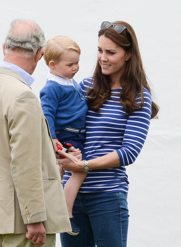 Prince Charles talks to Kate Middleton and Prince George.