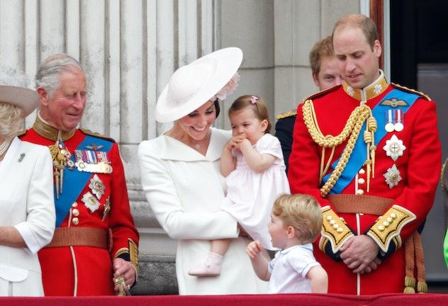 Prince George talks to grandpa Prince Charles.