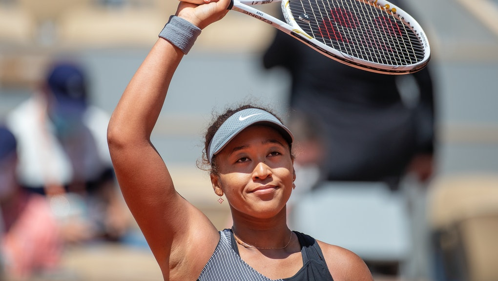 PARIS, FRANCE May 30.  Naomi Osaka of Japan celebrates her victory against Patricia Maria Tig of Romania in the first round of the Women's Singles competition on Court Philippe-Chatrier at the 2021 French Open Tennis Tournament at Roland Garros on May 30th 2021 in Paris, France. (Photo by Tim Clayton/Corbis via Getty Images)