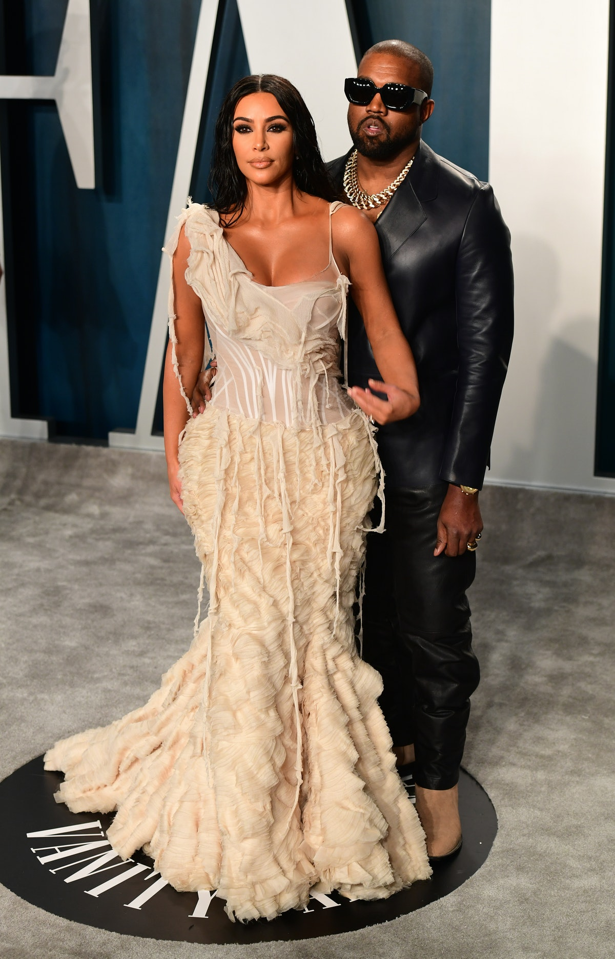"""Kim Kardashian, shown here in a white dress alongside Kanye West, said her marriage to her husband made her feel """"lonely."""""""