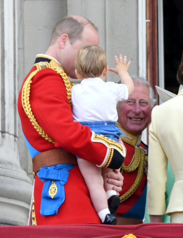 Prince Louis waves to his grandfather.