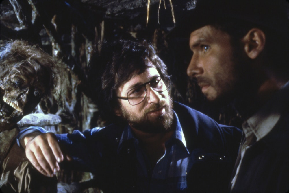 """American actor Harrison Ford and director Steven Spielberg on the set of """"Raiders of the Lost Ark"""". ..."""