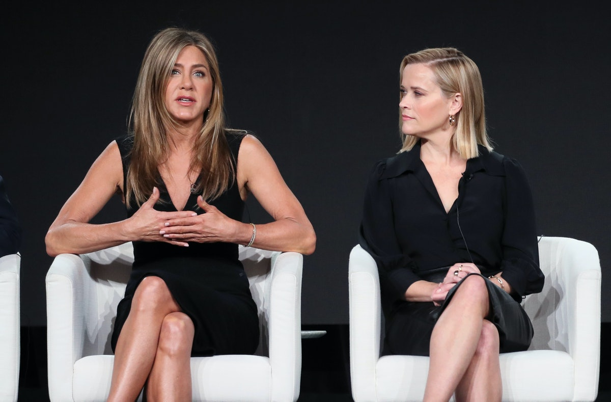 """Jennifer Aniston (L) and Reese Witherspoon of """"The Morning Show"""" speak on stage during the Apple TV+ segment of the 2020 Winter TCA Tour at The Langham Huntington, Pasadena on January 19, 2020 in Pasadena, California. (Photo by David Livingston/Getty Images)"""