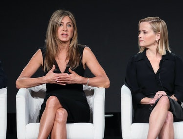 """Jennifer Aniston (L) and Reese Witherspoon of """"The Morning Show"""" speak on stage during the Apple TV+..."""