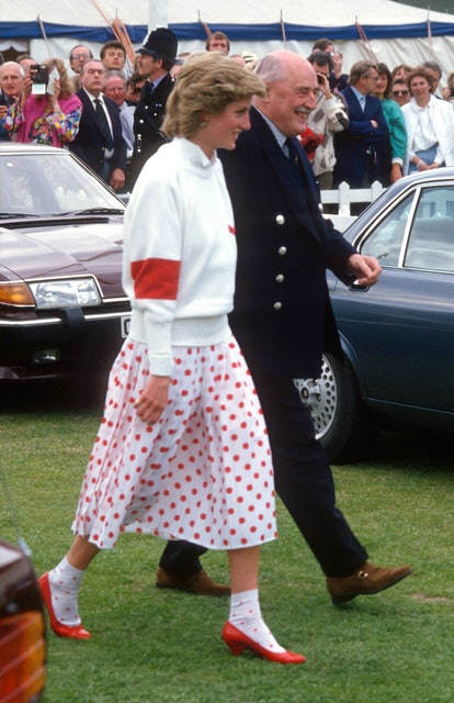 WINDSOR, ENGLAND - JUNE:  Diana, Princess of Wales, wearing a red and white polka dot skirt designed by Mondi with matching socks, a white jumper and red shoes, attends a polo match at Guards Polo Club in June 1986 in Windsor, United Kingdom. (Photo by Anwar Hussein/Getty Images)