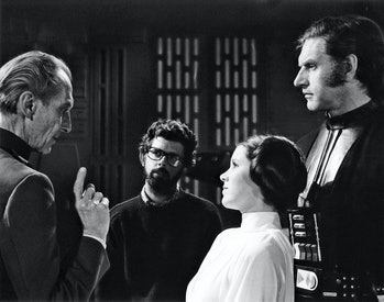 British actors Peter Cushing, David Prowse and American Actress Carrie Fisher with director, screenw...