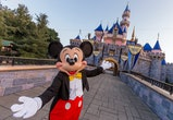 ANAHEIM, CA - AUGUST 27: Mickey Mouse poses in front of Sleeping Beauty Castle at Disneyland Park on August 27, 2019 in Anaheim, California. Disneyland plans to reopen on April 30, 2021.  (Photo Joshua Sudock/Walt Disney World Resorts via Getty Images)