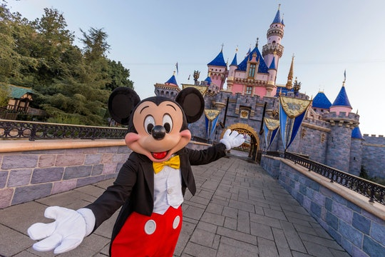 ANAHEIM, CA - AUGUST 27: Mickey Mouse poses in front of Sleeping Beauty Castle at Disneyland Park on...