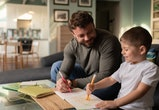 dad and little boy coloring together