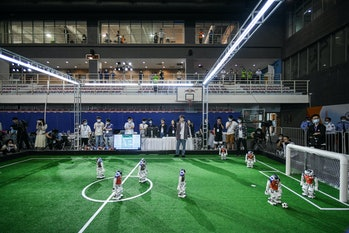 TIANJIN, CHINA - MAY 21: Robot soccer players compete in a soccer game during the 2021 RoboCup China...
