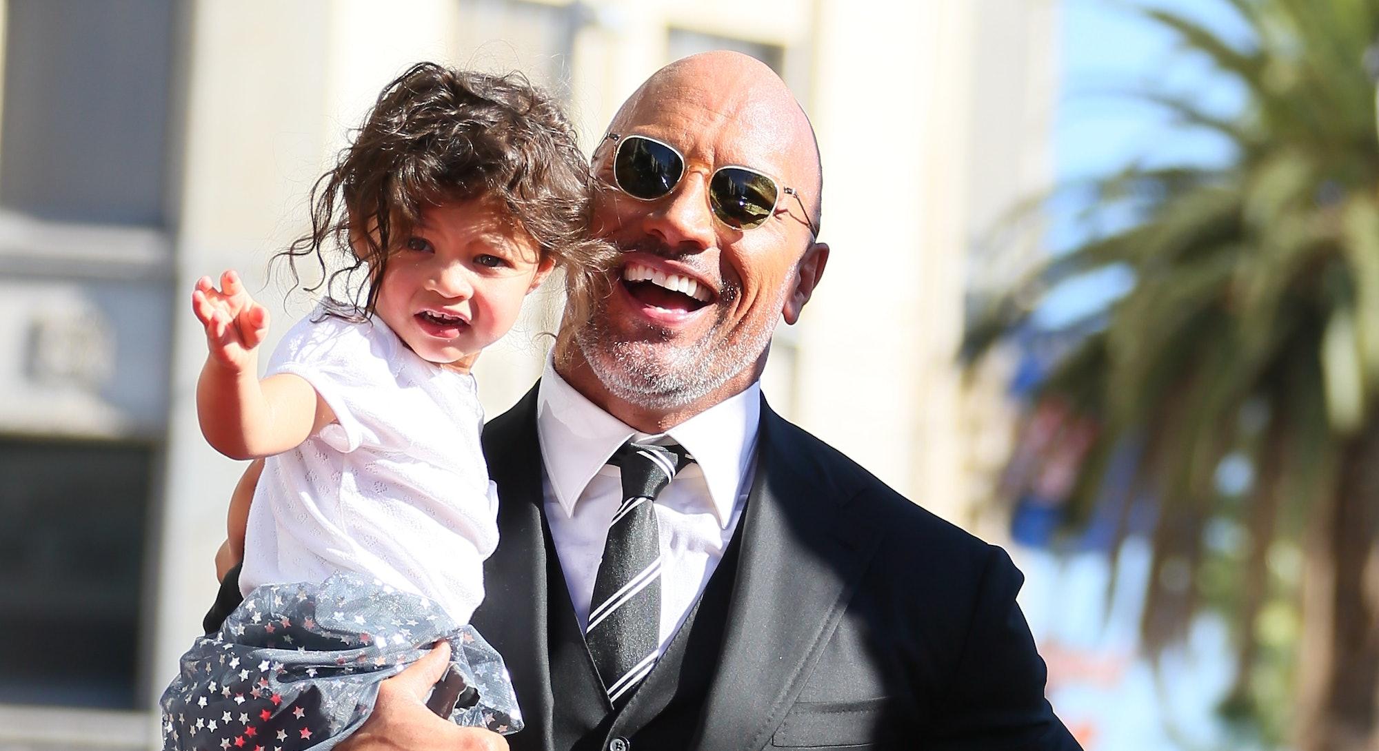 LOS ANGELES, CA - DECEMBER 13: Dwayne Johnson and daughter Jasmine Johnson attends a ceremony honori...