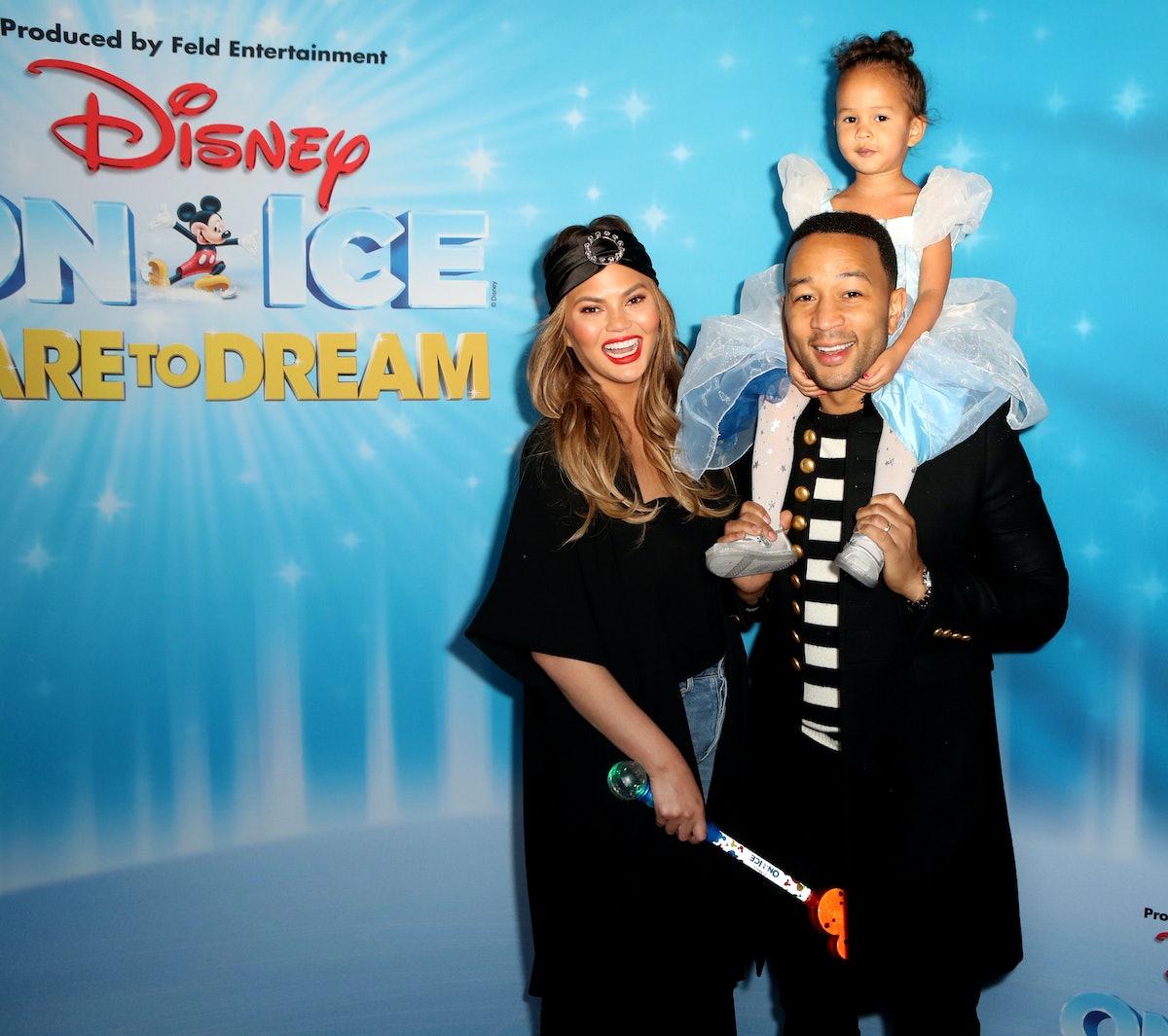 LOS ANGELES, CALIFORNIA - DECEMBER 14: Chrissy Teigen, John Legend and daughter Luna attend  Disney ...