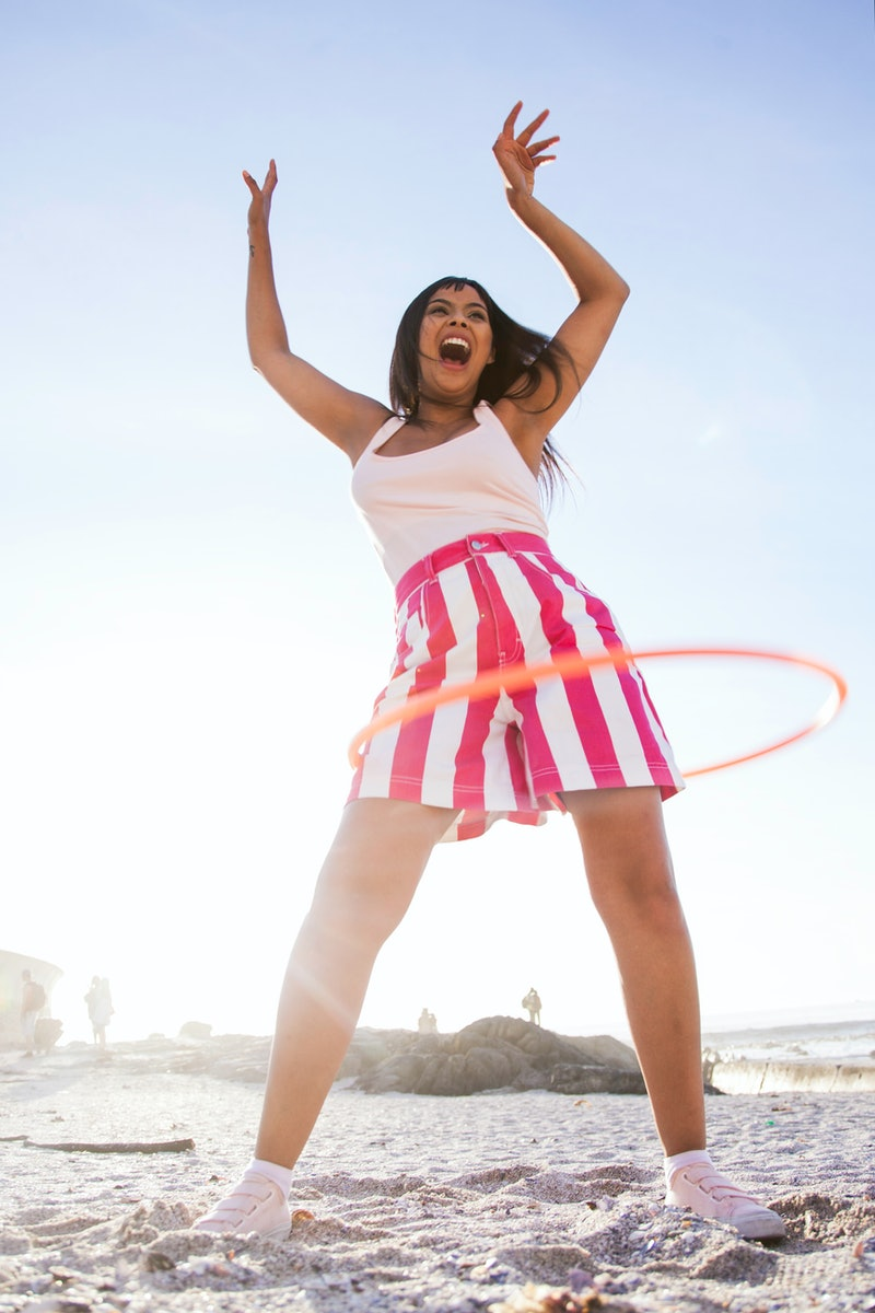 Get your sweat on with TikTok's #hulahoop workouts, a fitness modality that's trending on the app.