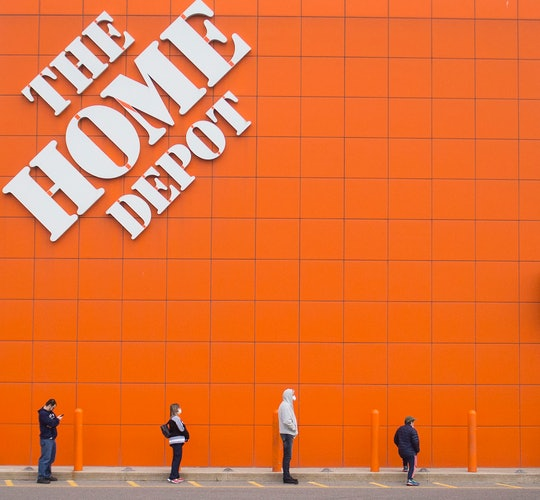 TORONTO, April 3, 2020 -- People line up with a social distance to enter a Home Depot store in Toron...