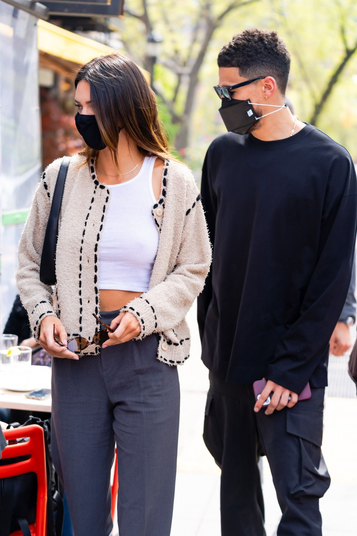 NEW YORK, NEW YORK - APRIL 24: Kendall Jenner (L) and Devin Booker are seen in SoHo on April 24, 202...