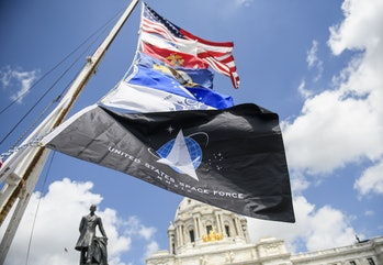 ST. PAUL, MN - MAY 22: A United States Space Force flag hangs from a pole, with flags of other armed...