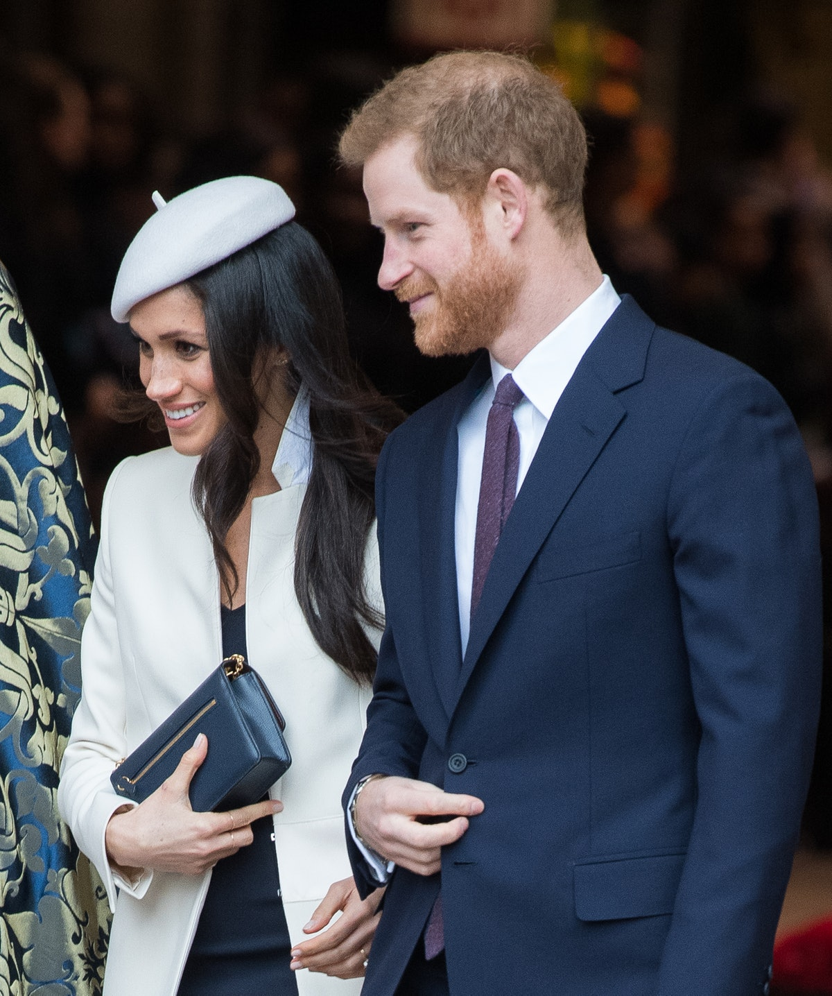 """Meghan Markle's body language was """"slightly possessive"""" when she started publicly dating Prince Harr..."""