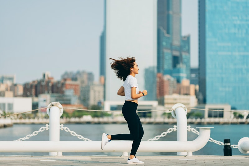 Young sports woman running outdoors
