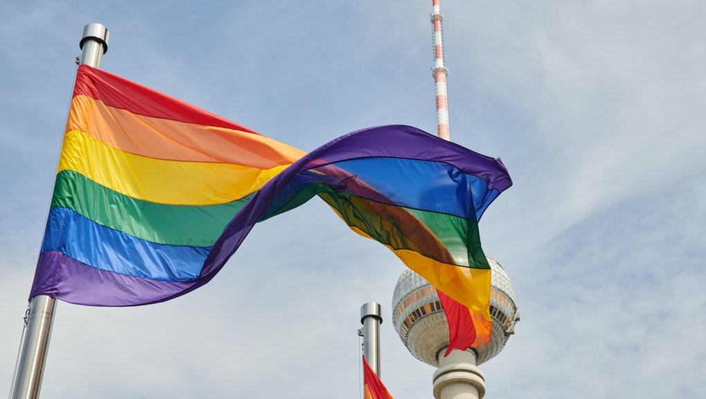 01 June 2021, Berlin: A rainbow flag flies in front of the TV tower. Four such colorful flags were h...