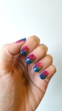 If you're in the market for some nail art ideas, try a '90s-inspired, rainbow animal print that would make Lisa Frank proud.