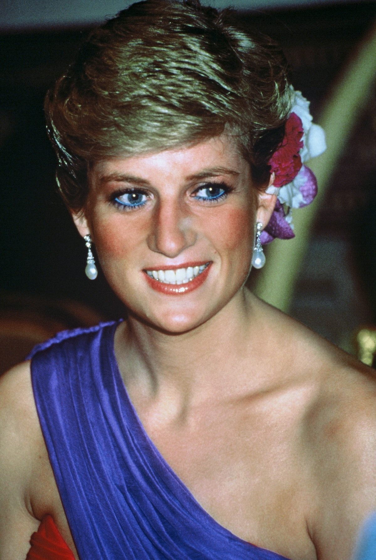 One of Princess Diana's most iconic hair moments: a chic updo with flowers.
