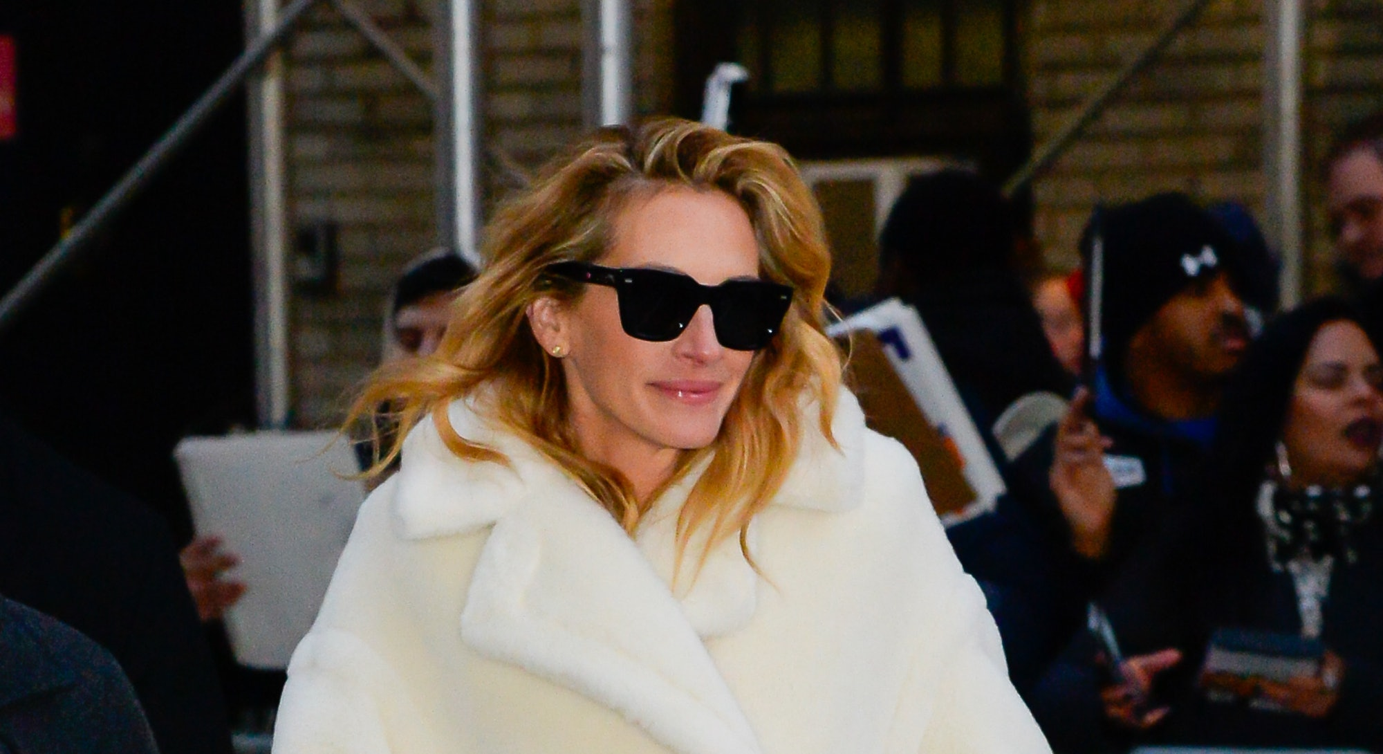 Actor Julia Roberts wears a cream ovesize coat for The Late Show with Stephen Colbert on December 4, 2018 in New York City.