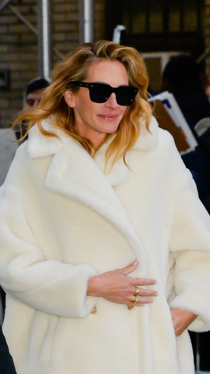 Actor Julia Roberts wears a cream ovesize coat for The Late Show with Stephen Colbert on December 4,...