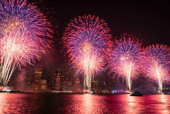 Brooklyn, New York: Colorful Fourth of July fireworks over the East River south of Brooklyn seen fro...