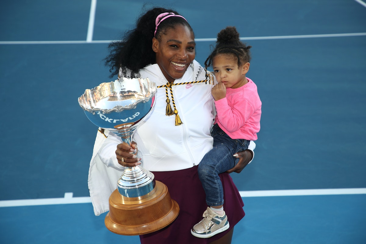 erena Williams of the USA holds her daughter Alexis Olympia with the trophy following the Women's Fi...