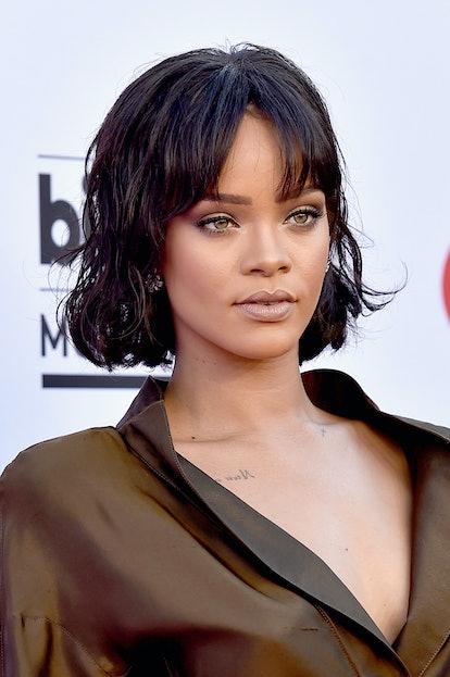 Rihanna shows how to wear curtain bangs with a short shaggy cut.