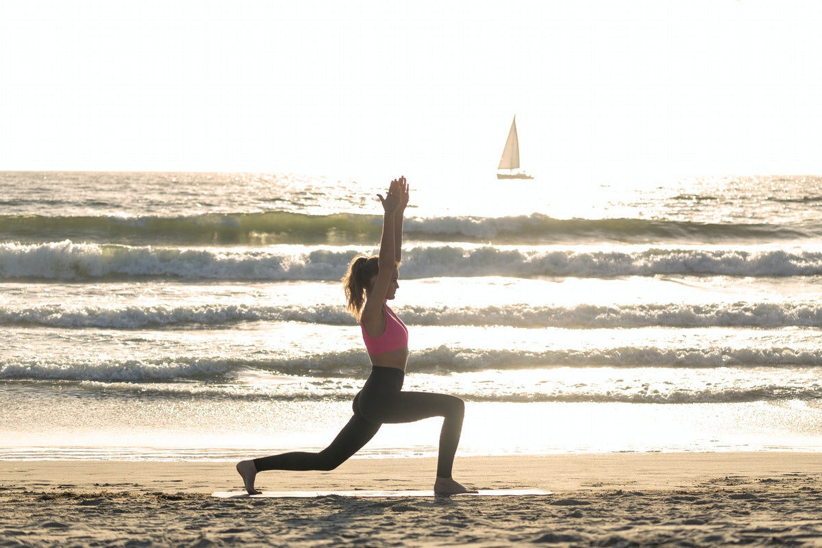 woman doing a yoga workout who may be looking for a caption or quote for instagram photos.