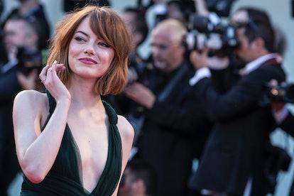 Emma Stone wears a blunt bob with curtain bangs.