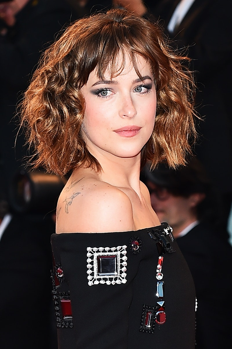 Experts explain how to wear short hair with curtain bangs.