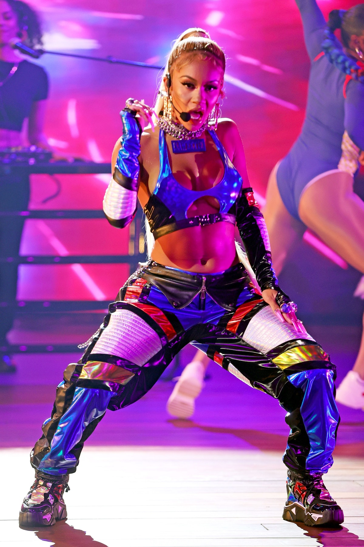 Saweetie, shown here on stage performing, is a total cancer.